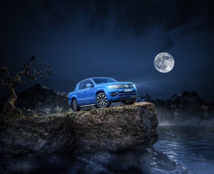 Volkswagen Amarok 2016 vampire full moon night version on a rock in the middle of the lake